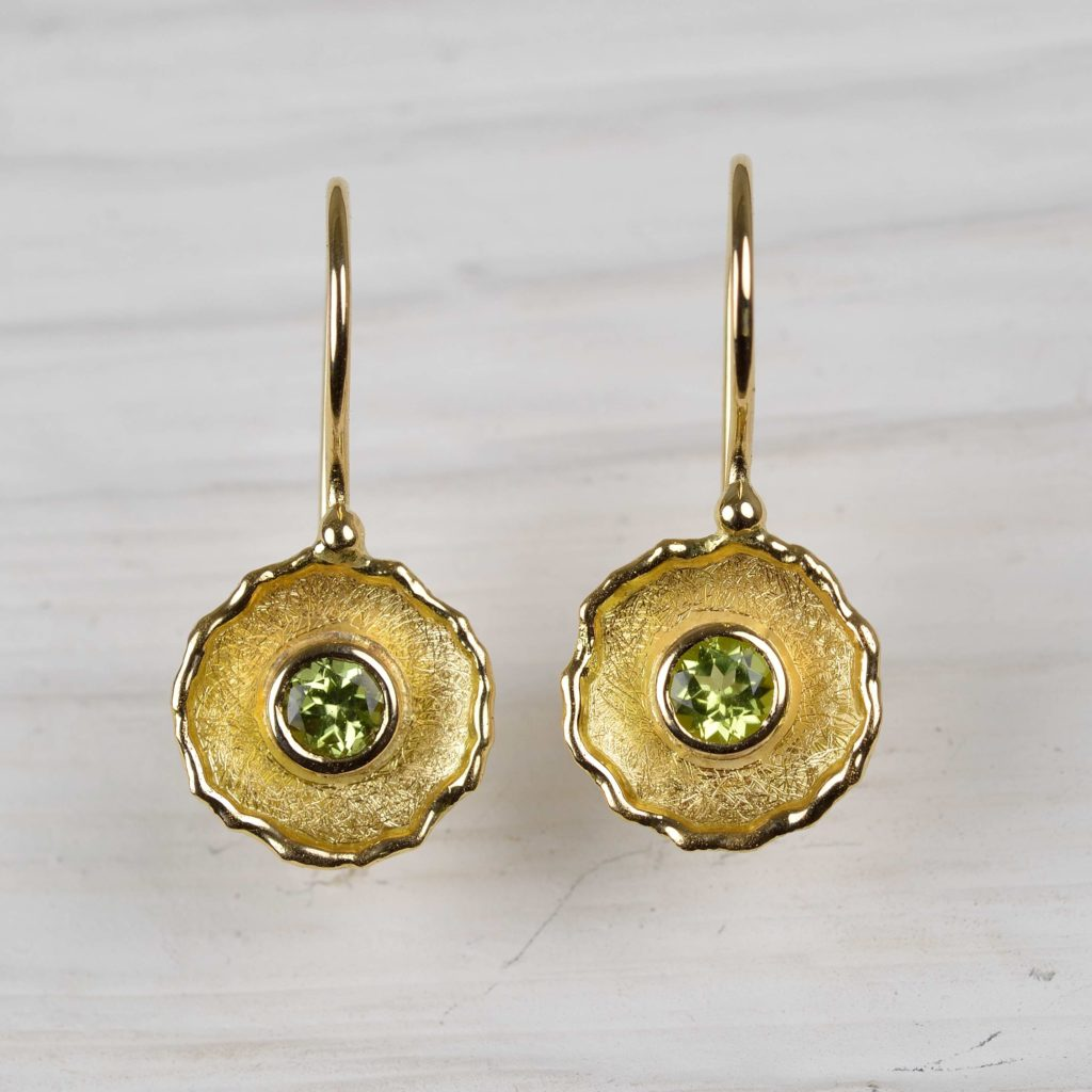 18ct gold earrings with peridots