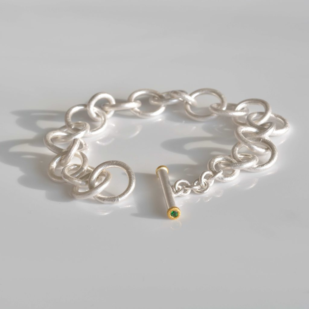 fine silver and fine gold bracelet with tsavorites