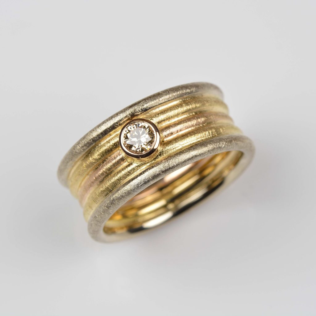 18ct red, yellow and white gold ring with champagne diamond