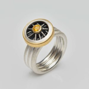 sterling silver and 22ct gold ring with yellow sapphire