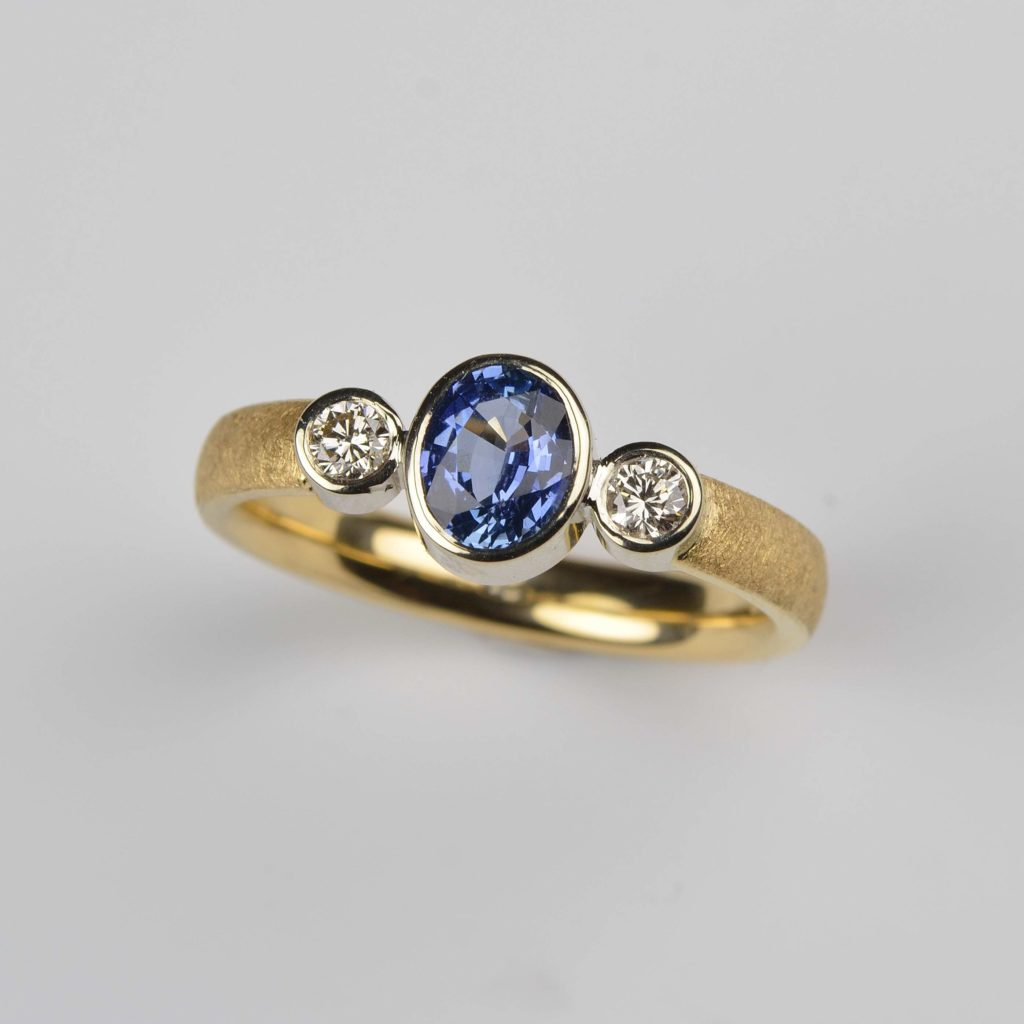 18ct yellow and white gold ring with tanzanite and diamonds
