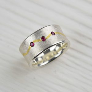 sterling silver and fine gold ring with rubies