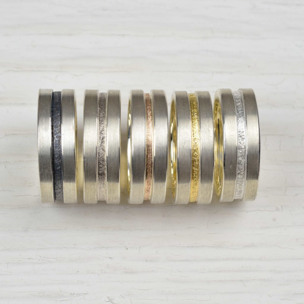 sterling silver and 18ct gold rings