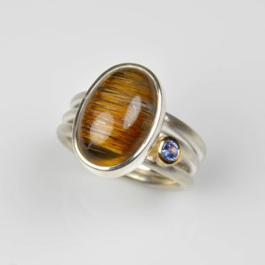 sterling silver and 18ct gold ring with rutile quartz and sapphire