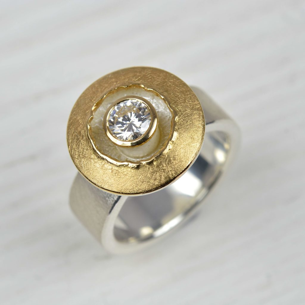 sterling silver and 18ct gold ring with diamond