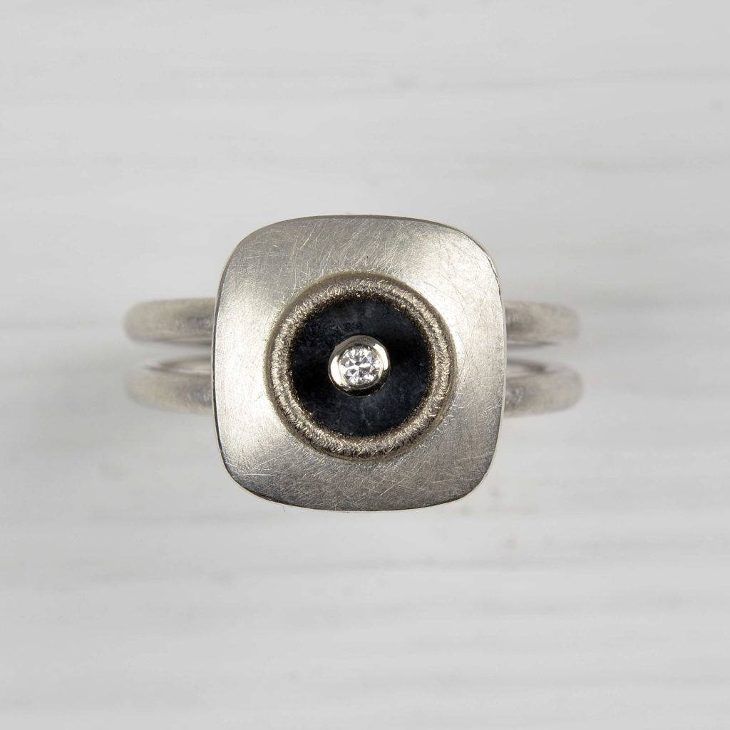 sterling silver and 18ct white gold ring with diamond
