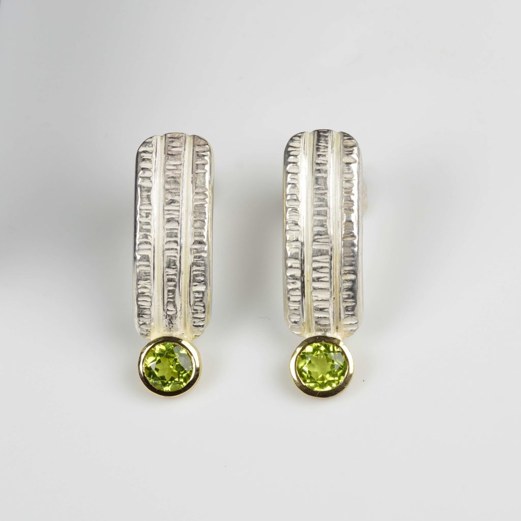 sterling silver and 18ct gold studs with peridots