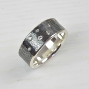 oxidised sterling silver hammered ring with diamonds