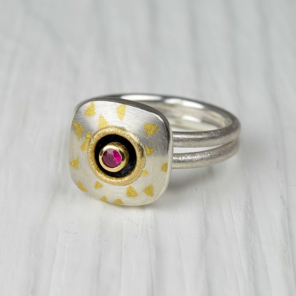 sterling silver, 18ct gold and finegold ring with ruby
