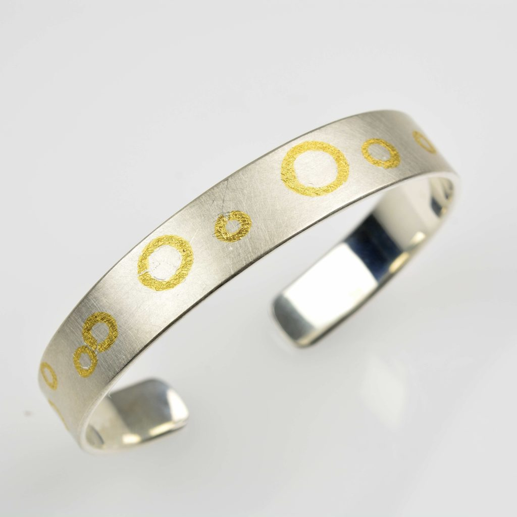 sterling silver bangle with fused fine gold