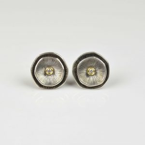 silver and 18ct gold studs with diamond