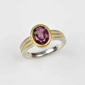 sterling silver and 22ct gold ring with rhodolite